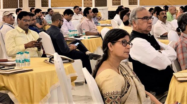 Men and women watching a presentation at the India Building Regulatory Capacity Assessment Workshop in Dehradun, India