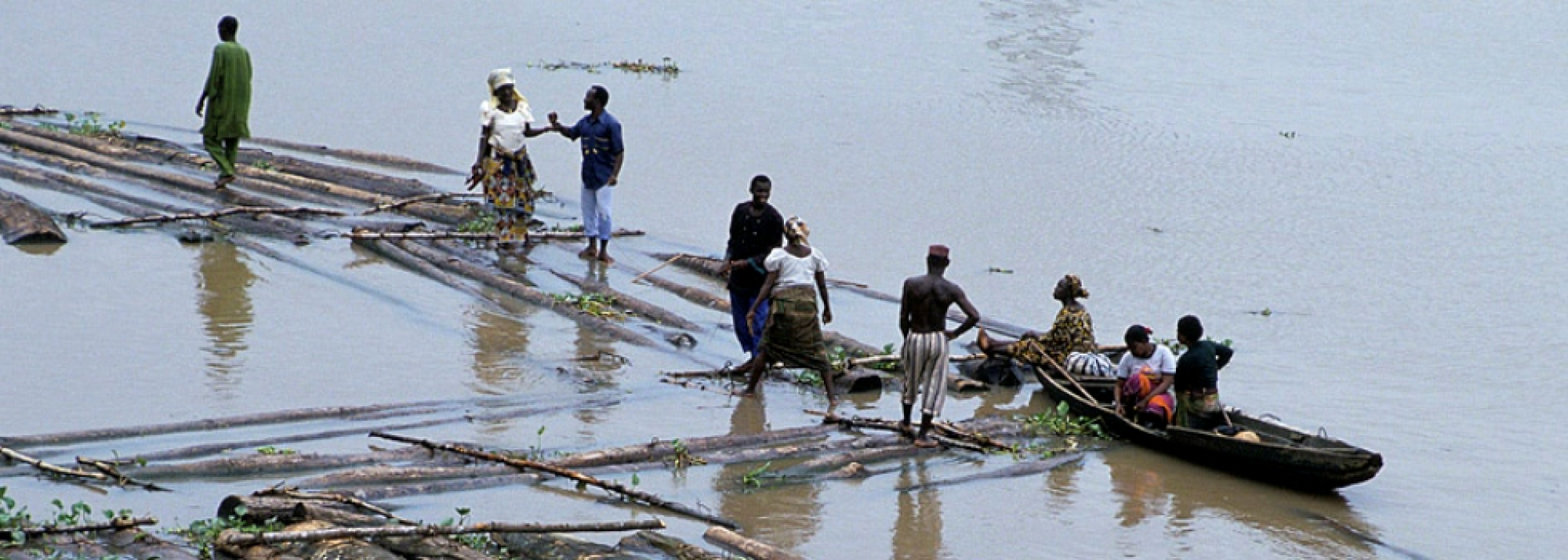 People traveling on rafts and boats in Nigeria.
