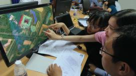 Local city officials and university students in Can Tho, Vietnam collaborate and learn about innovative mapping technology