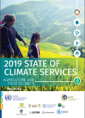 "A woman and a young girl walk across a grassy hill with a terraced landscape in the background. Superimposed on top of them is a document title, ""2019 state of climate services"""