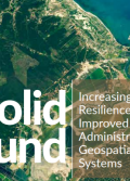 A satellite image of a village in a grassy area. Superimposed on top are the words solid ground: increasing community resilience through improved land administration and geospatial information systems